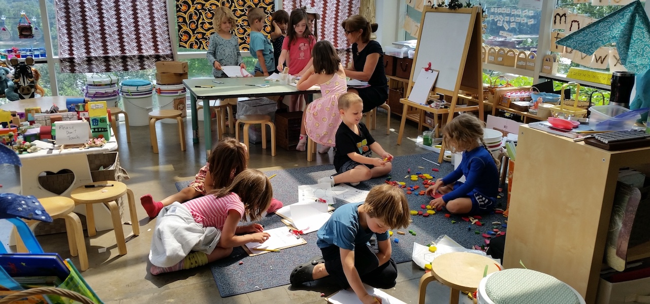 Kindergarteners Working And Playing