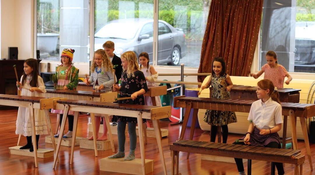 Children plating marimbas